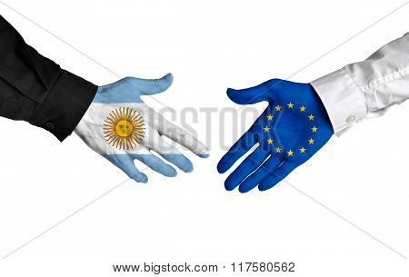 Argentina and European Union leaders shaking hands on a deal agreement