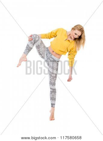 Beautiful sporty woman make stretching exercise. Studio photo isolated on white background.