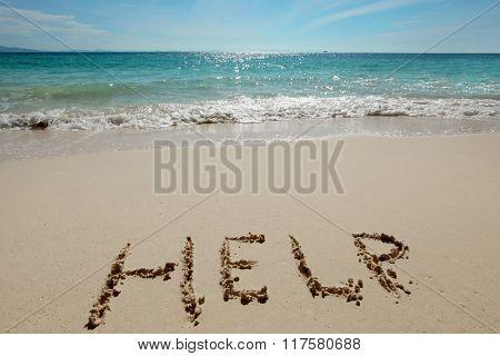 Help Sign on the sand of tropical sea beach