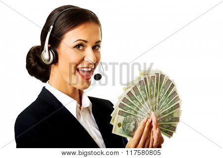 Call center woman holding polish bills