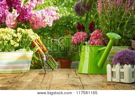 Gardening tools on the wood table in the garden