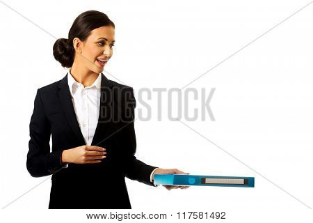 Businesswoman giving a binder