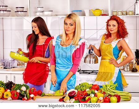 Happy group women preparing vegetable food at kitchen.