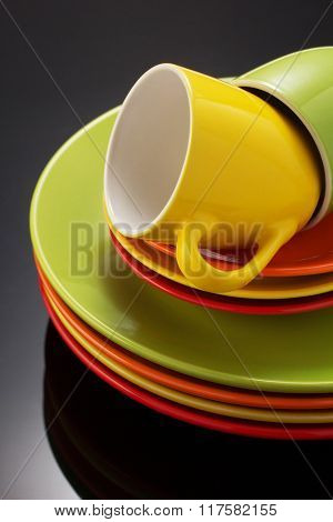 set of dishware on black background