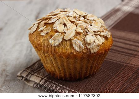 Fresh Muffin With Oatmeal Baked With Wholemeal Flour On Checkered Tablecloth, Delicious Healthy Dess