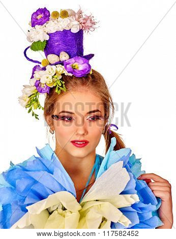 Portrait woman with false eyelashes in easter dress  holding  flowers. Isolated.