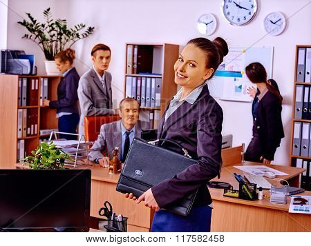 Group business people in office. Happy woman on foreground.