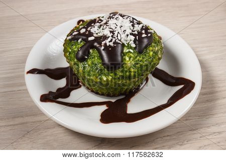 Fresh Muffin With Spinach, Desiccated Coconut And Chocolate Glaze, Delicious Healthy Dessert
