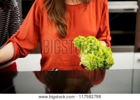Woman in the kitchen preparing some food.