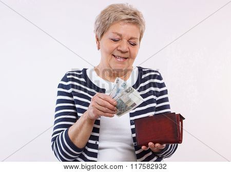 Happy Senior Female Holding Wallet With Polish Currency Money, Concept Of Financial Security In Old