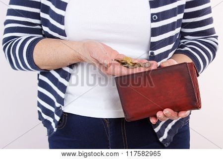 Hands Of Senior Woman With Coins And Leather Wallet, Concept Of Financial Security In Old Age