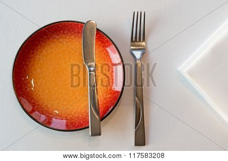 Starter Meal Setup With Red Hot Plate And White Napkin Decoration. Selective Focus.