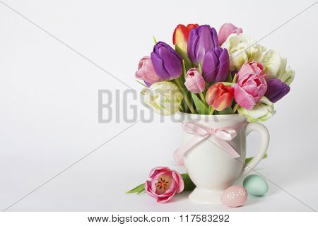 Beautiful tulips bouquet and easter eggs  - spring, easter or gardening concept