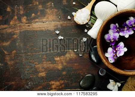 Close up of flowers floating in bowl of water and SPA setting
