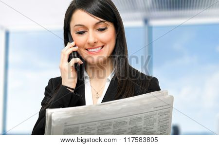Businesswoman at the phone in her office