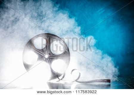 Old reel of film with smoke and back-light
