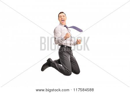 Ecstatic businessman jumping in the air and gesturing happiness isolated on white background