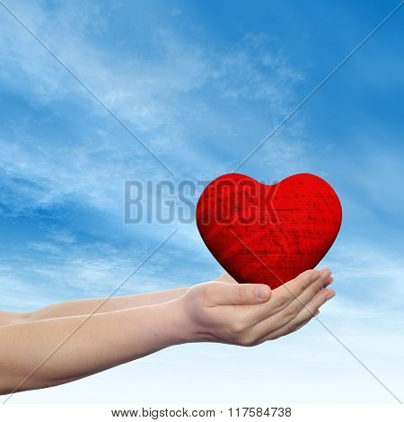 Concept or conceptual 3D red abstract heart sign or symbol held