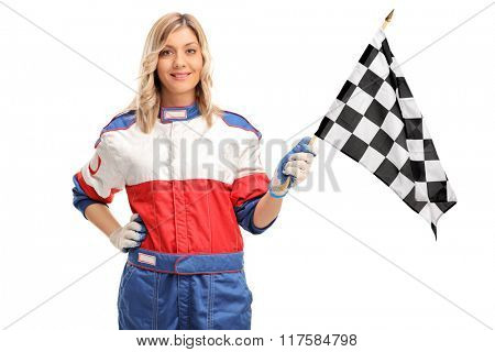 Young female car racer waving a checkered race flag and looking at the camera isolated on white background