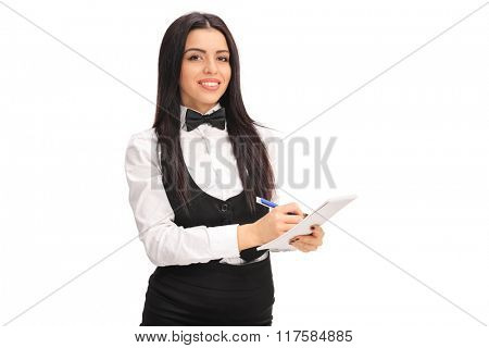 Studio shot of a young waitress writing on a notepad isolated on white background