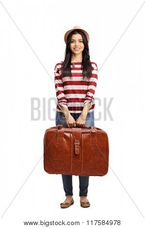 Full length portrait of a cheerful young woman holding a brown briefcase isolated on white background