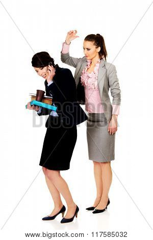 Woman try to get attention from her busy partner.
