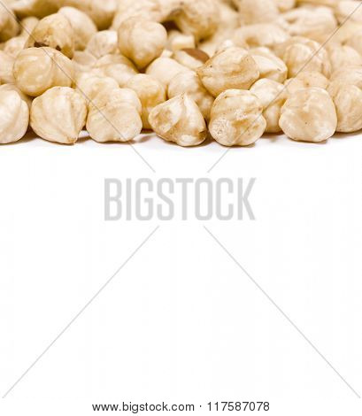 A bunch of hazelnuts on a white background