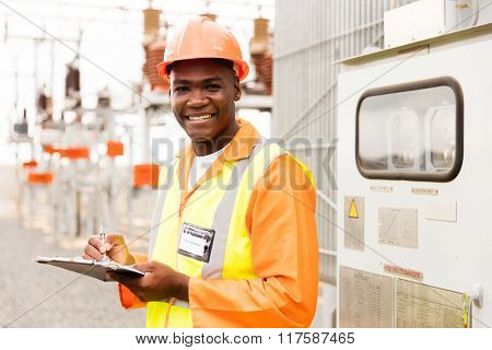 senior technician holding clipboard in substation