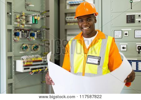 good looking senior technical worker in substation control room