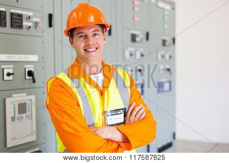 portrait of smiling electric worker in control room