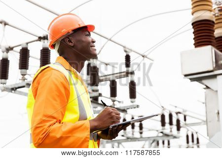 male african electrical worker in substation