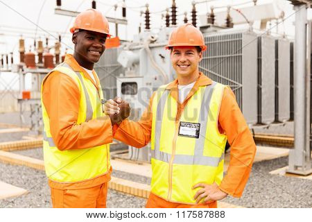 portrait of electrical engineers working together in substation