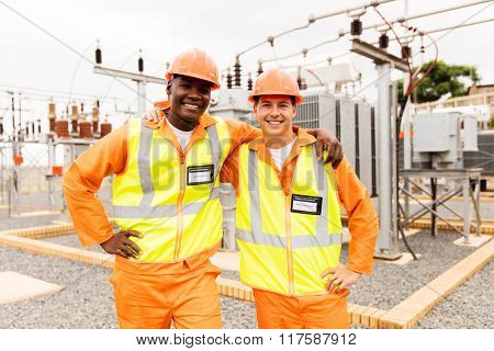 handsome electrical engineers standing in power plant