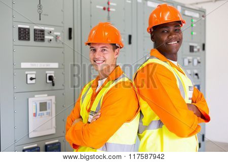 handsome young industrial engineers with arms crossed