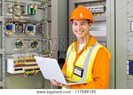 professional control room engineer using laptop