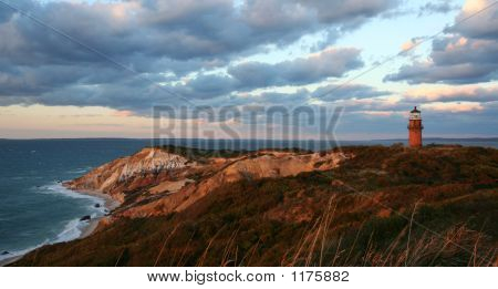 Sunset Over Lighthouse And Red Cliffs At Martha'S Vineyard