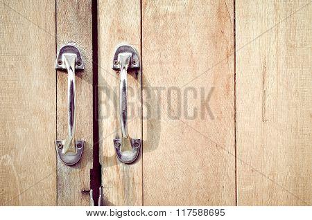 Steel door handles natural wooden door