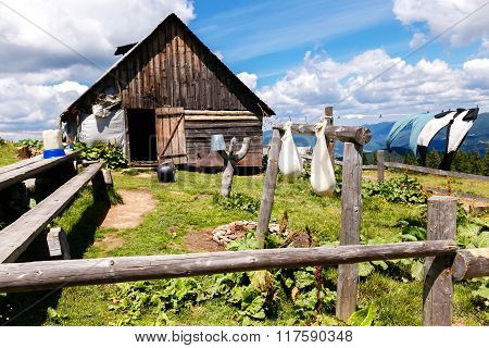 Household With Hanging Ripening Cheese In The Mountains