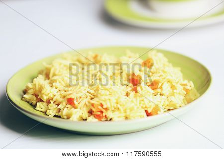 Stewed rice with a carrot on a , close up