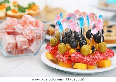 Set of cold snacks, canape and dessert, closeup