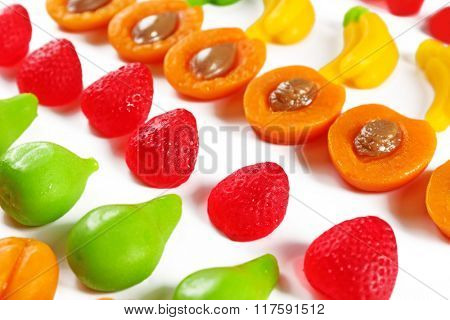 Set of lined colourful fruit jelly sweets, close-up