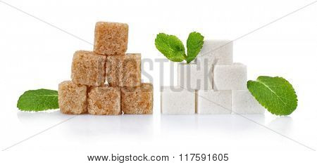 Pile of sugar cubes and stevia isolated on white background
