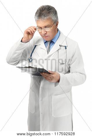 A handsome doctor with stethoscope and clipboard, isolated on white