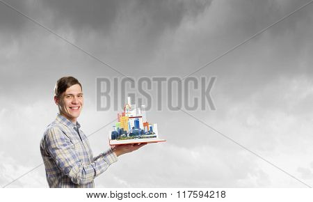 Guy with red book in hands