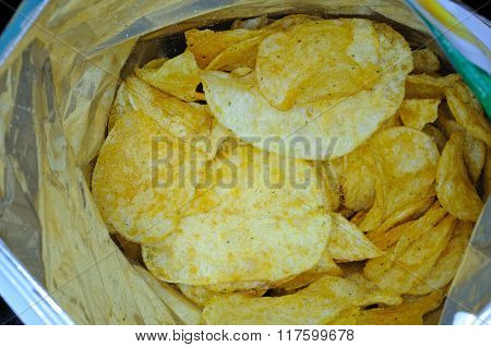 Packet of potato chips.