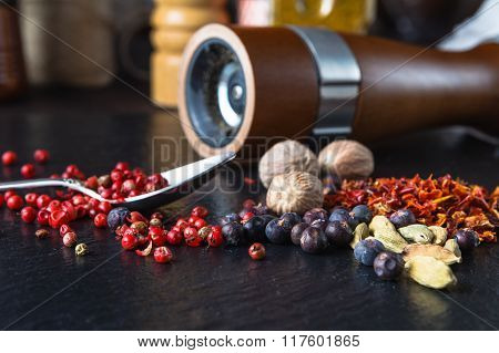 Pepper Mill With Pepper On A Slate Background