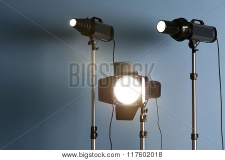 Studio light flashes on light blue wall background