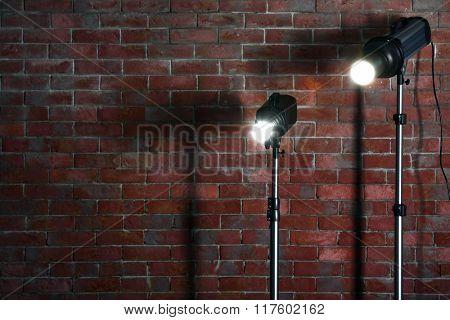 Studio light flashes on brick wall background
