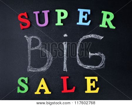 Super big sale concept on a blackboard background