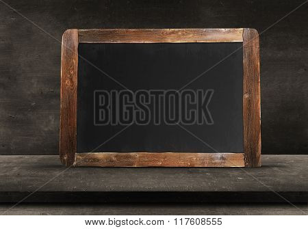 Wooden chalkboard on wood floor